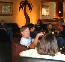 Friends chatting in Meduros' lounge area